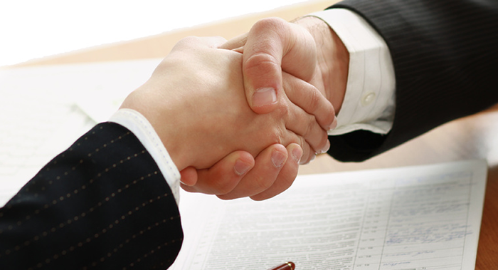 men shaking hands bankruptcy servicing