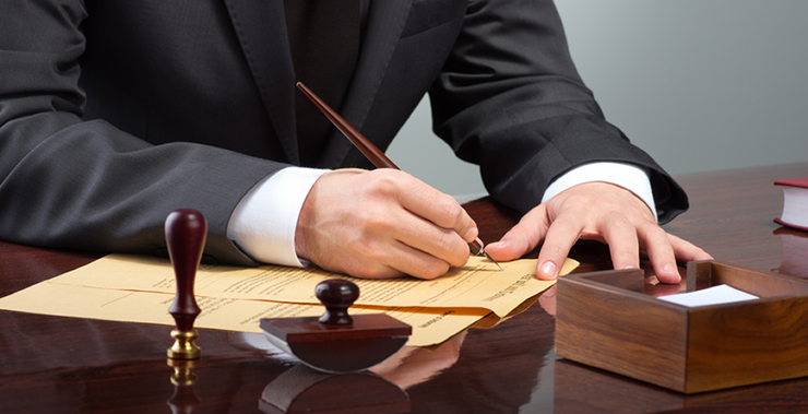 Lawyer signing corporate litigation papers