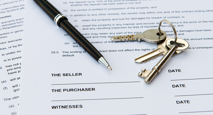 Real Estate documents with keys